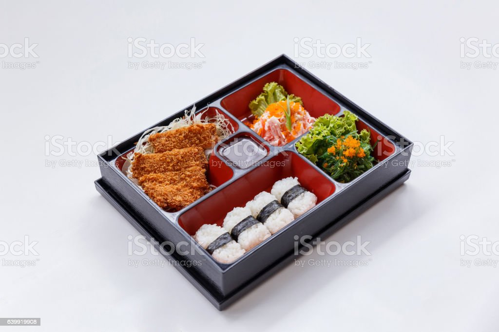 Tonkatsu Bento with Seaweed Salad with Ebiko and Kani Salad. stock photo