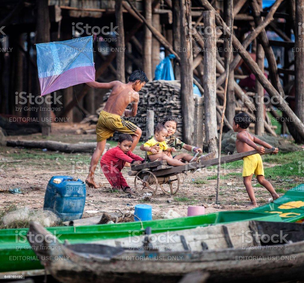 Tonle Sap, Kids playing stock photo