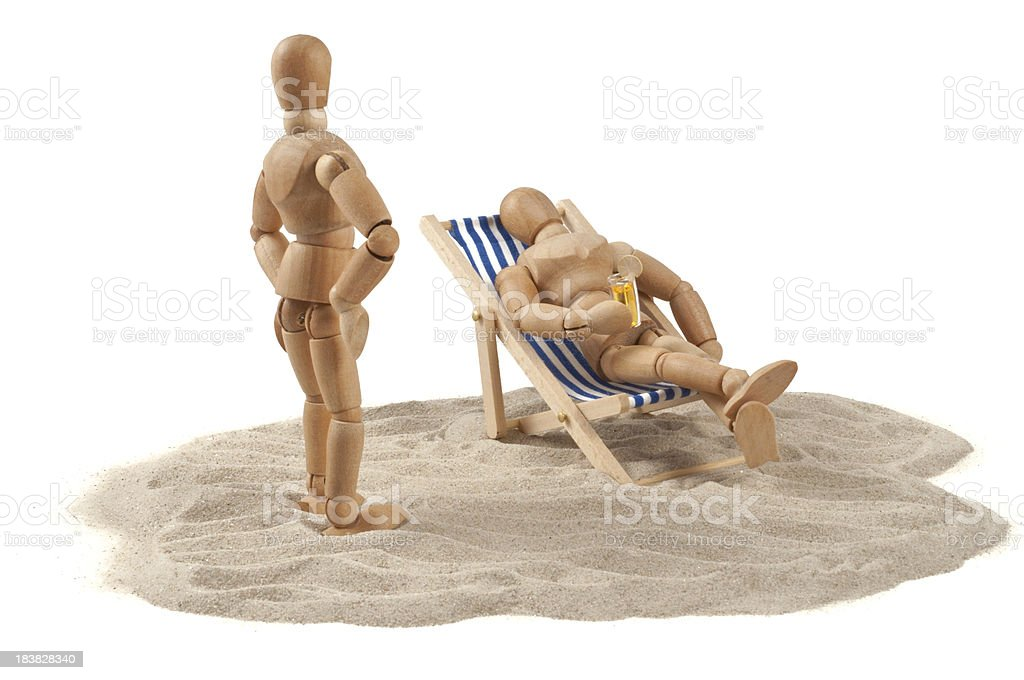 too lazy in deckchair? - wooden mannequins on beach stock photo