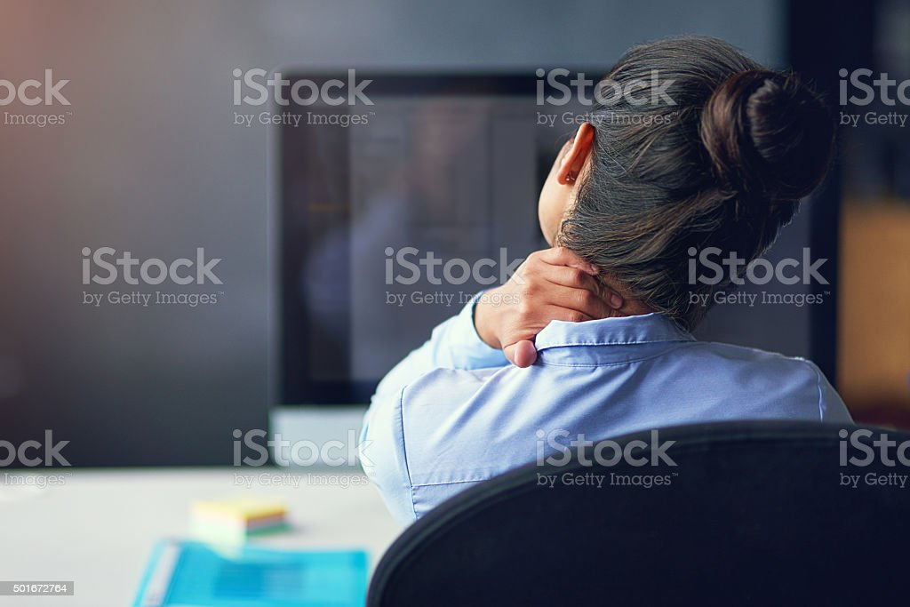 Too many hours in front of the computer... stock photo
