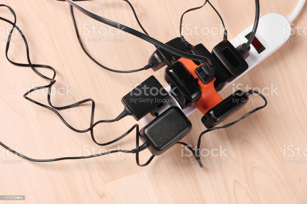 Too Many Wall Chargers! stock photo