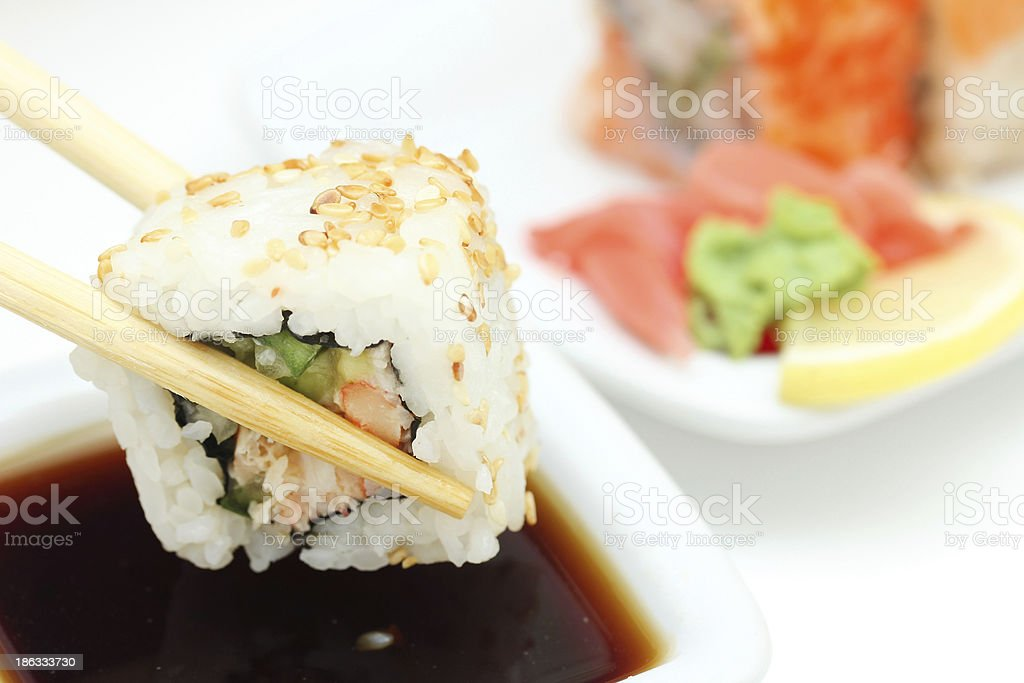 Took a sushi roll by the chopsticks royalty-free stock photo