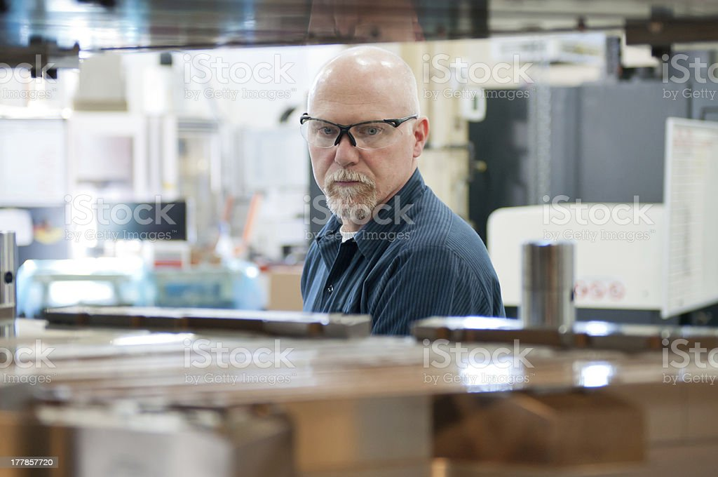 Tool and Die maker wearing safety glasses royalty-free stock photo
