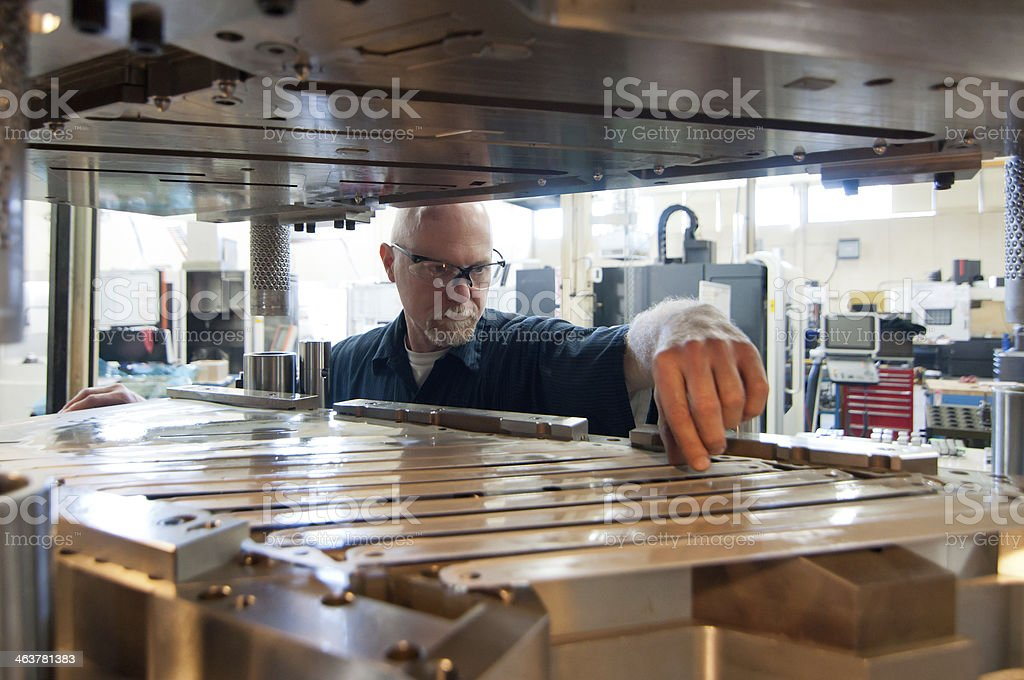 Tool and Die maker wearing safety glasses stock photo