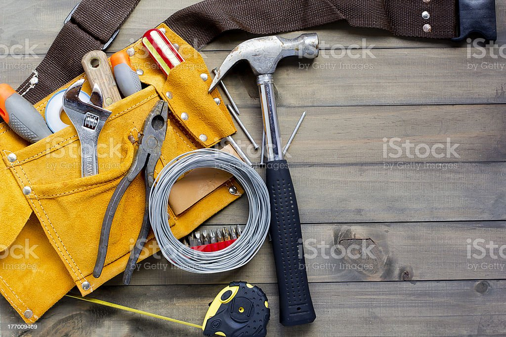 tool belt stuffed with various tools stock photo