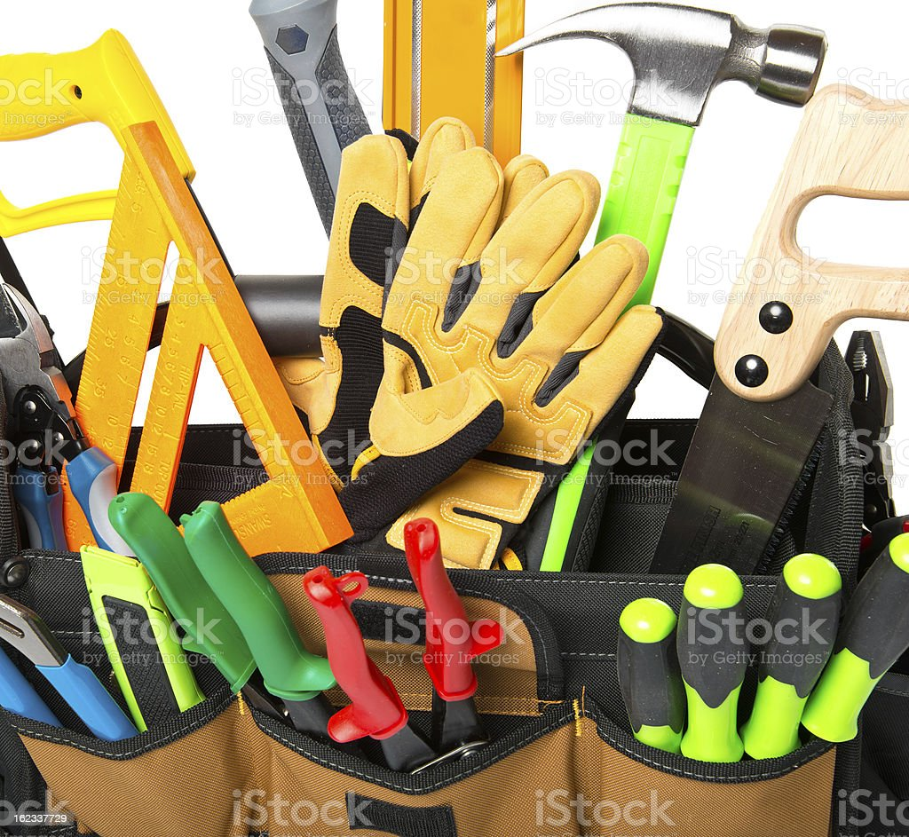 Tool box stuffed with construction equipment, isolated,  high re stock photo