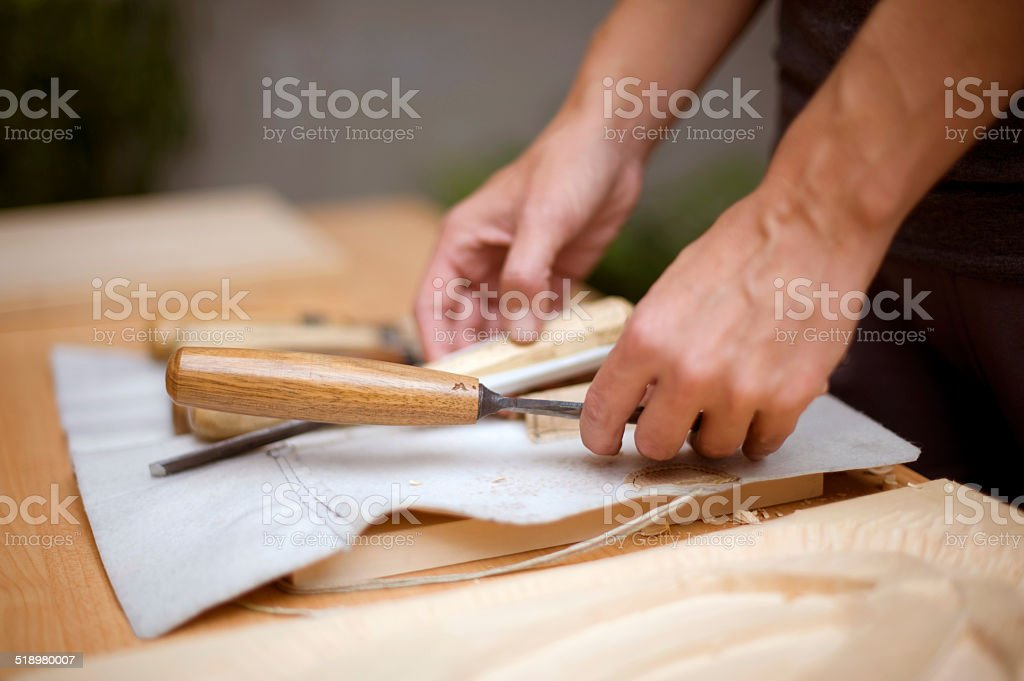 Tool for wood carving on table with artist stock photo