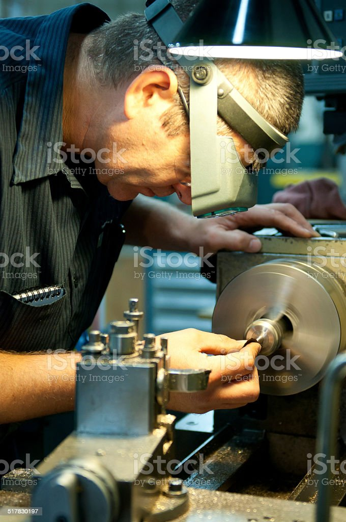 Tool Maker on a Lathe stock photo