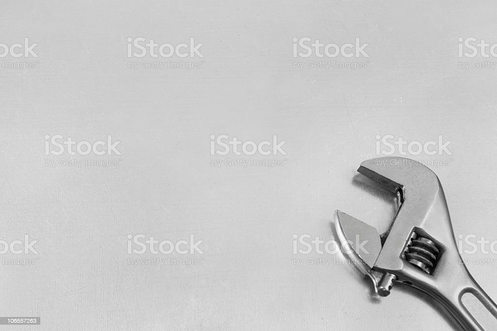 Tool on a sheet of stainless steel royalty-free stock photo