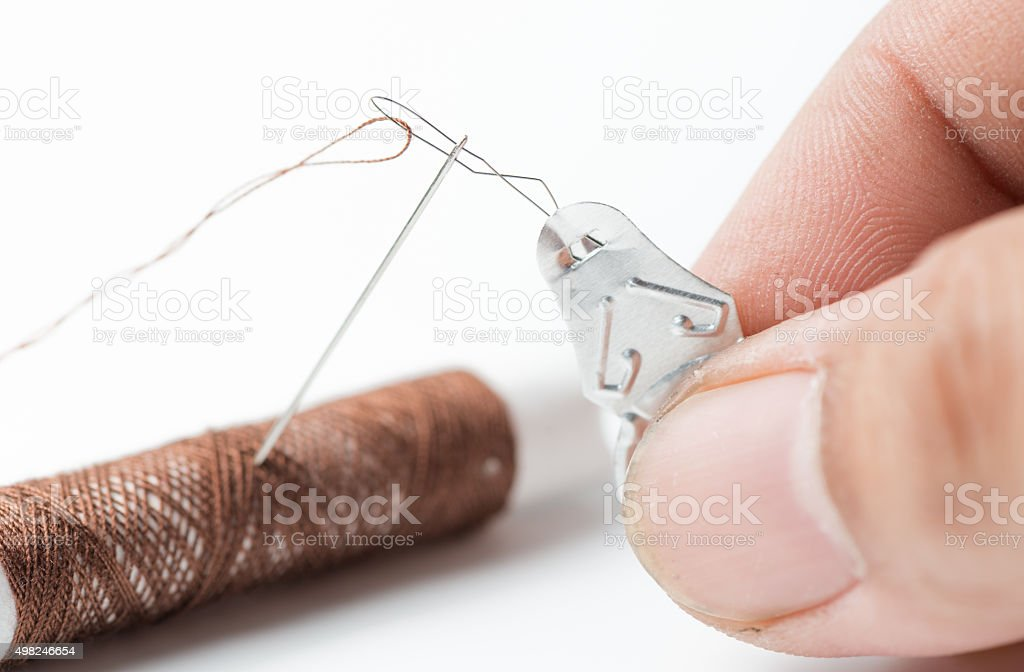 Tool used to thread needles with fine thread. stock photo