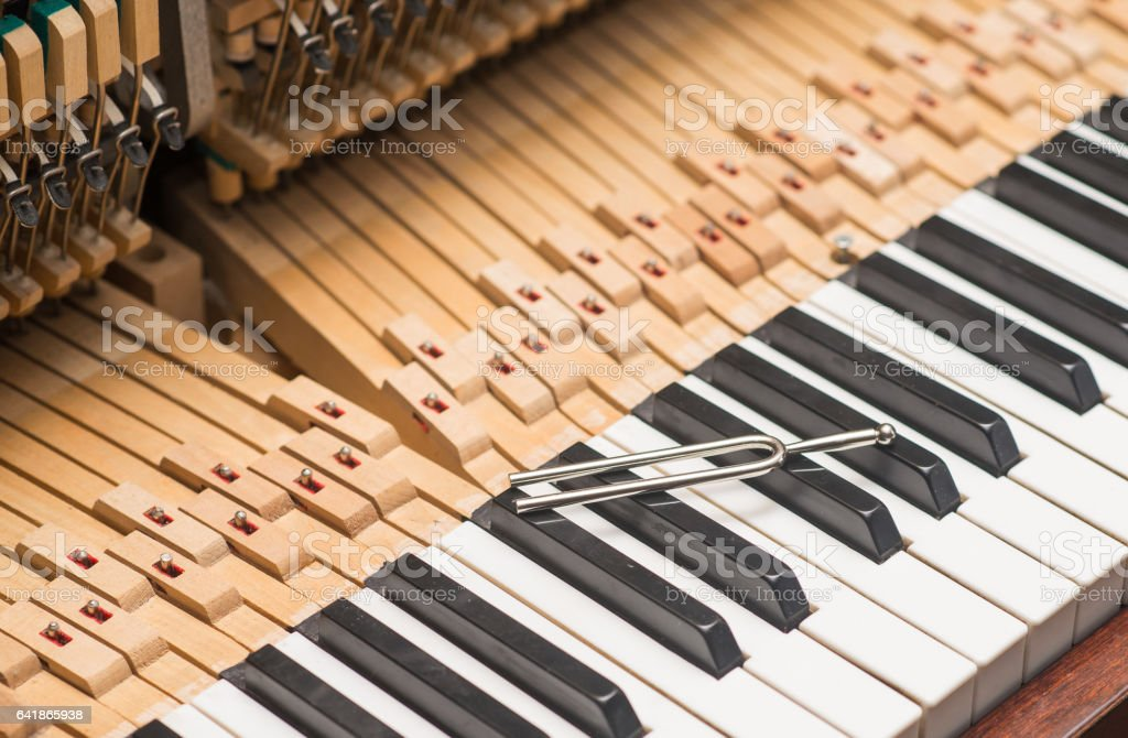tool with vintage piano hammer mechanism. Prepare to repair stock photo
