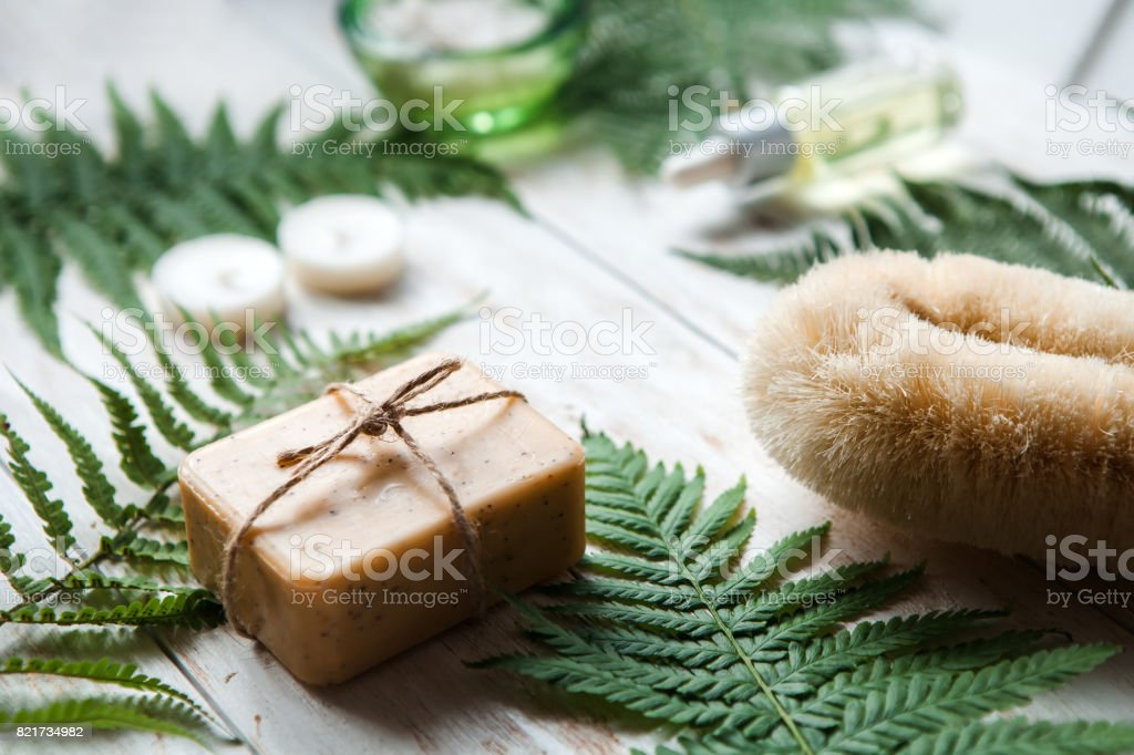 tools and accessories for spa treatments and relaxation. .Spa setting with natural olive soap and sea salt stock photo