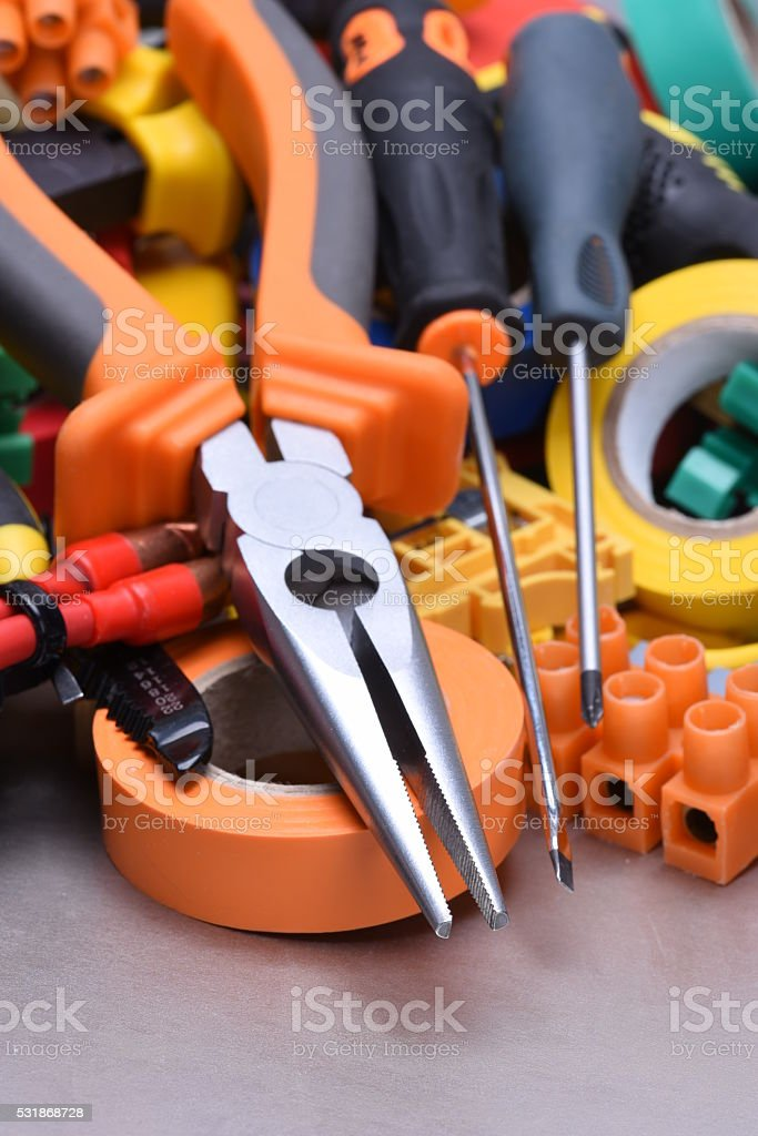 Tools and accessories used in electrical installations stock photo