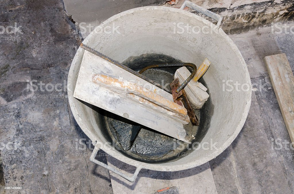 tools and cement in a bucket stock photo