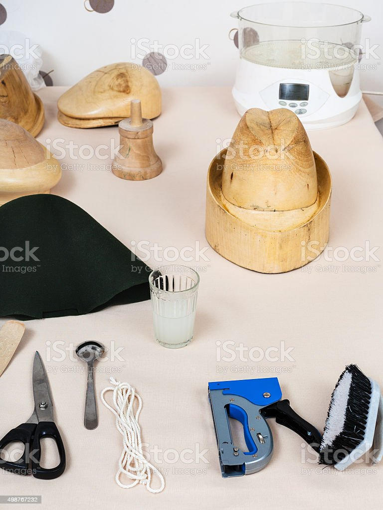 tools and equipment for hatmaking on table stock photo
