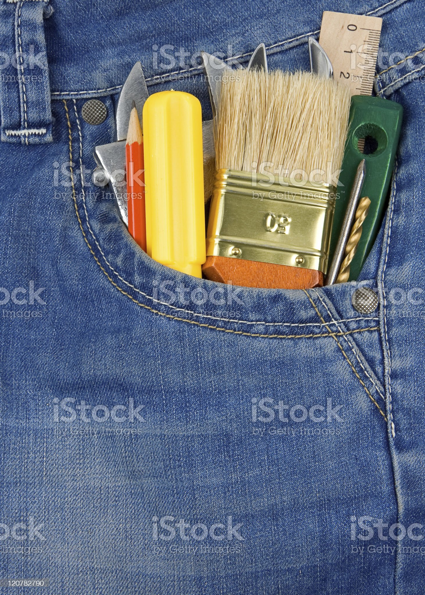 tools and instruments in jeans pocket royalty-free stock photo