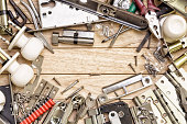 Tools and mortise lock arranged in a frame.