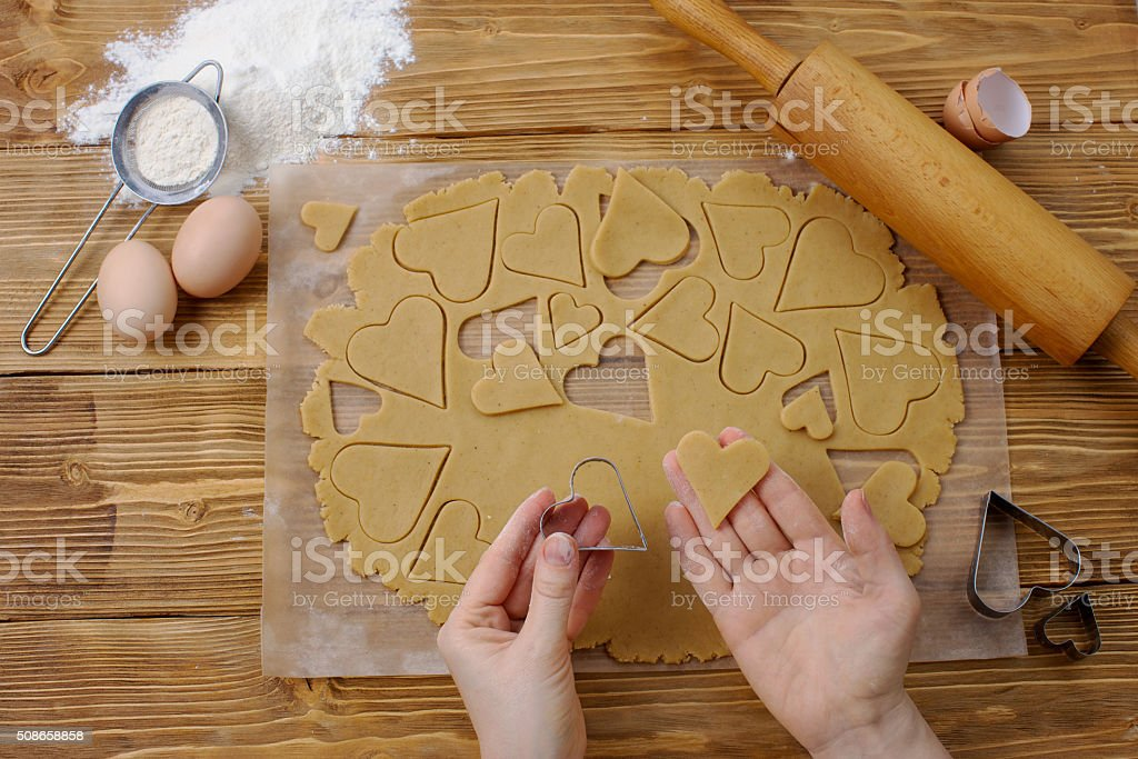 Tools and process of making heart cookies stock photo