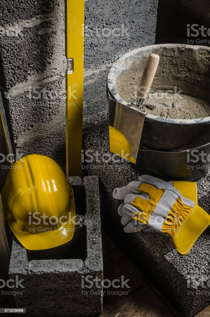 Tools for bricklayer bucket with a solution and a trowel, close- stock photo