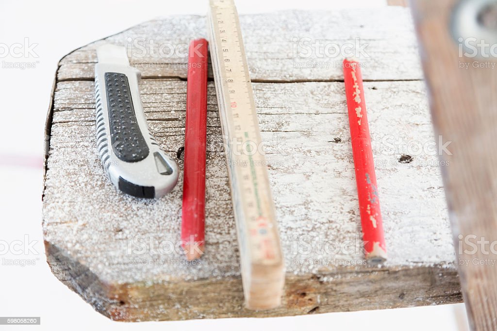 Tools for construction on wooden board stock photo