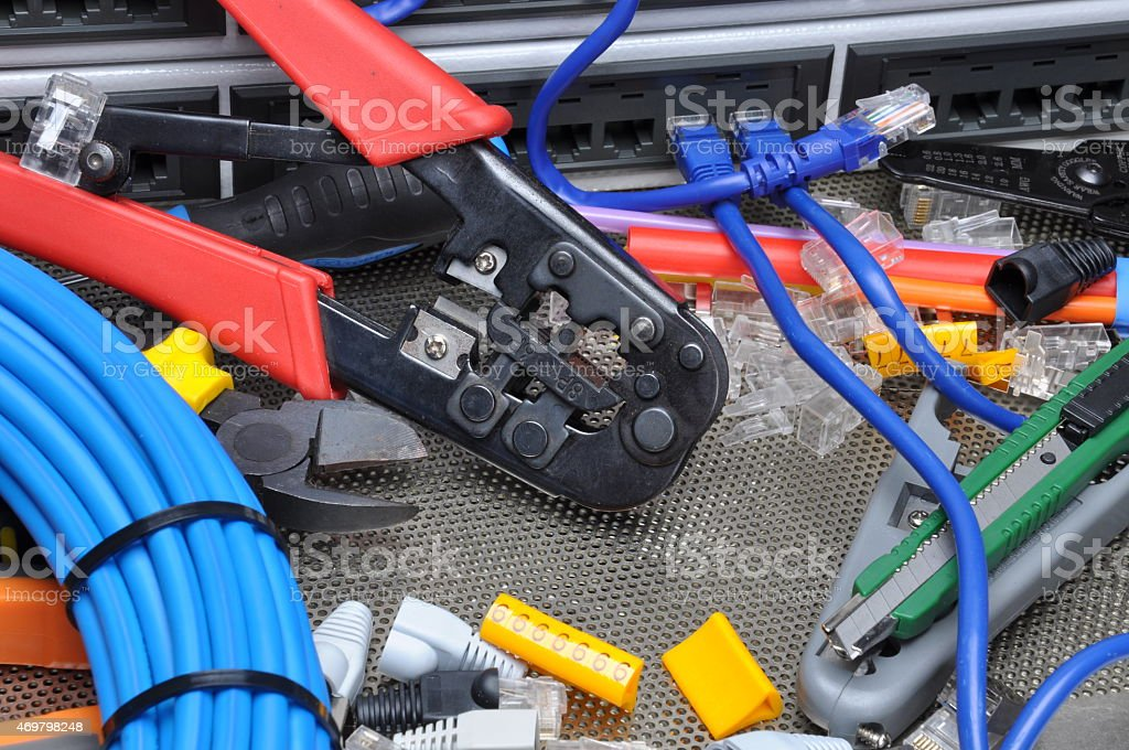 Tools for crimping with component to computer network stock photo