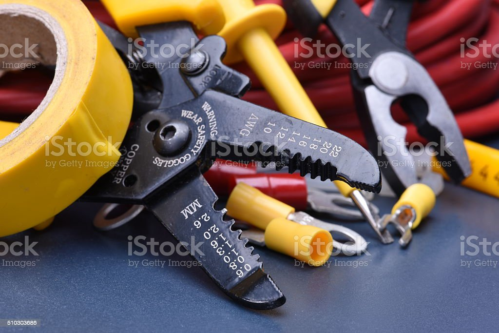 Tools for electrician and cables on metal surface stock photo