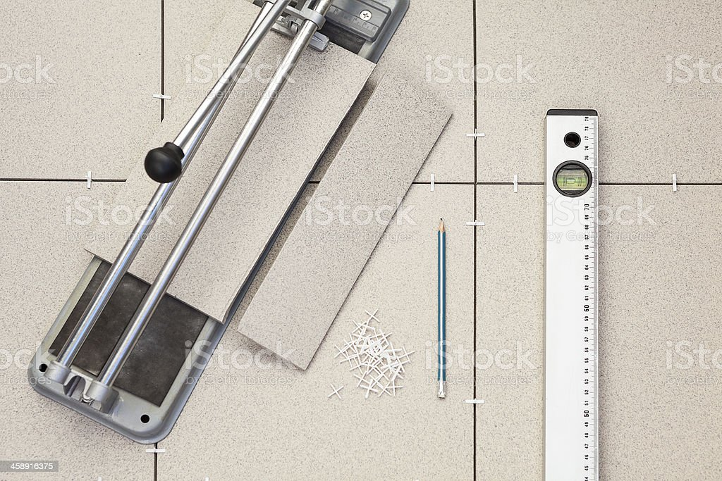 Tools for installing the floor of ceramic granite royalty-free stock photo