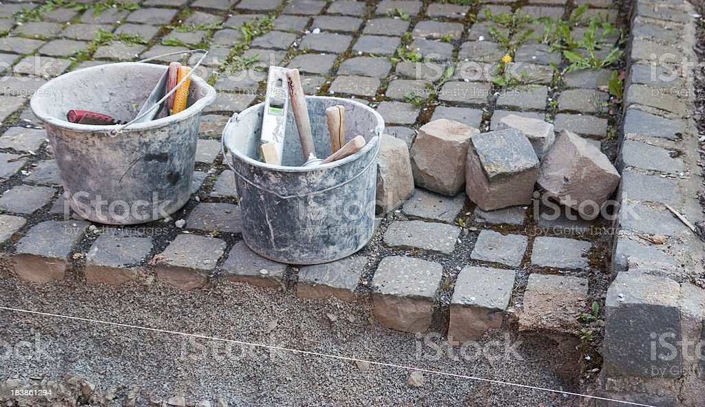Tools for laying cobblestones royalty-free stock photo