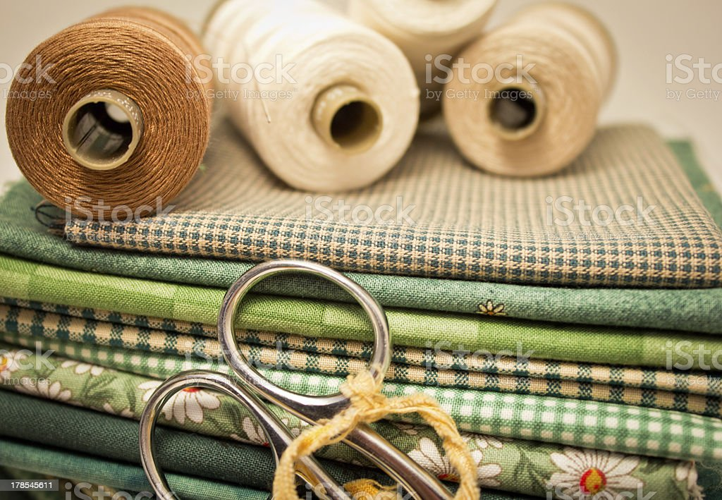 tools for patchwork in green stock photo