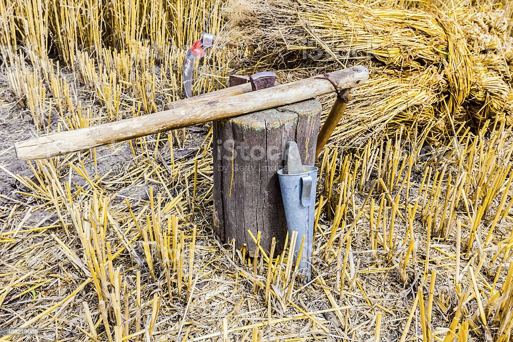 Tools for sharpening a scythe stock photo