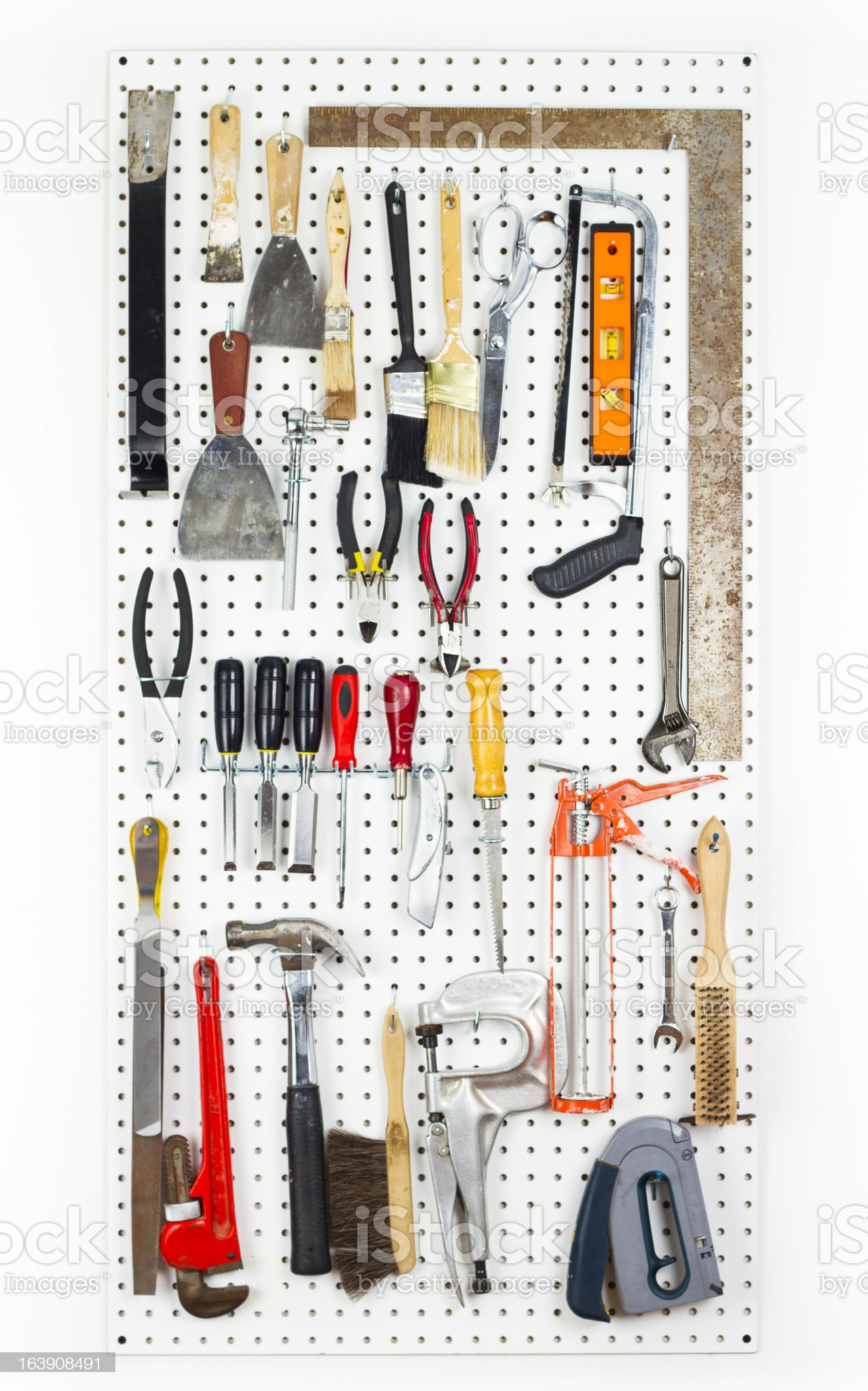 Tools hanging On An Organized pegboard royalty-free stock photo