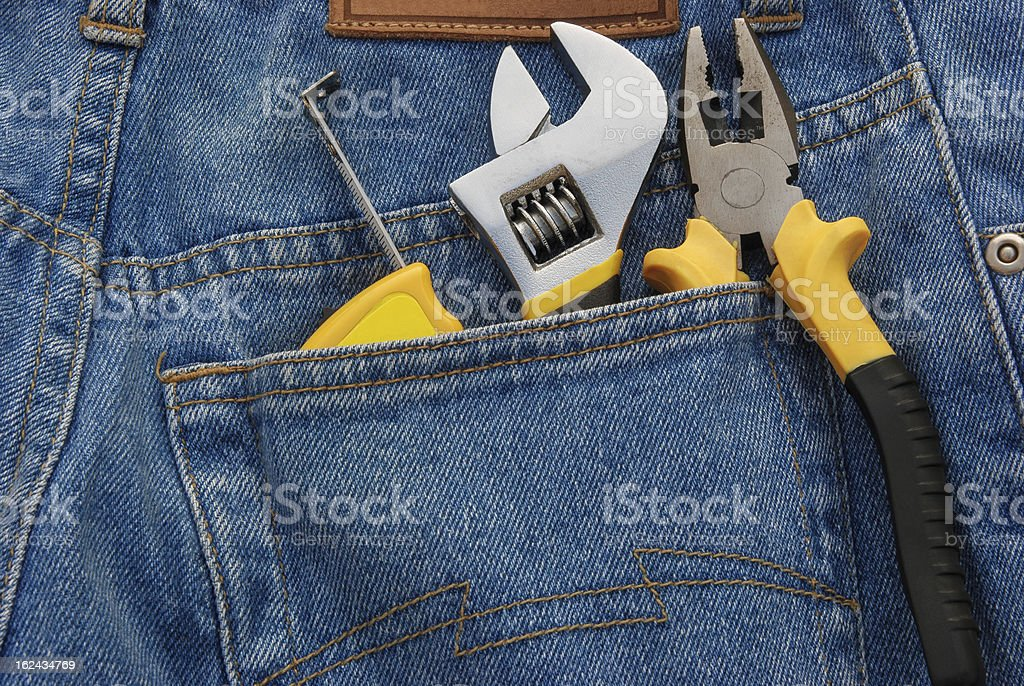 tools in a blue jean back pocket royalty-free stock photo