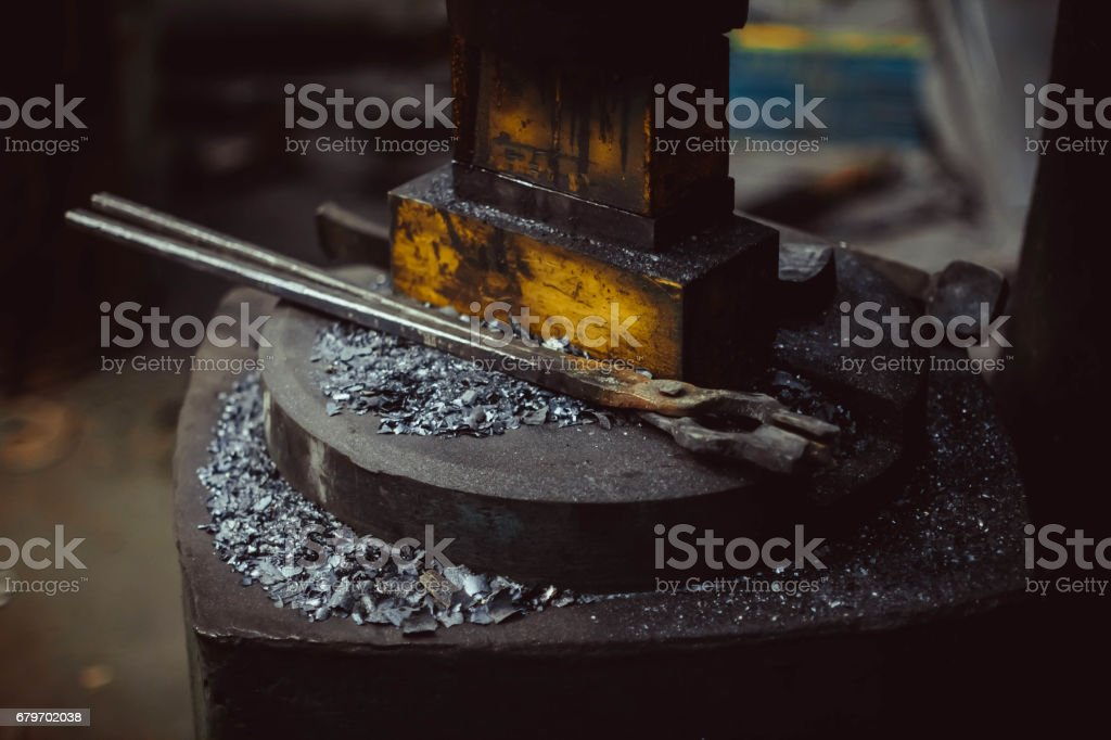 tools in the forge stock photo