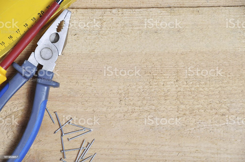 Tools on a wooden background royalty-free stock photo