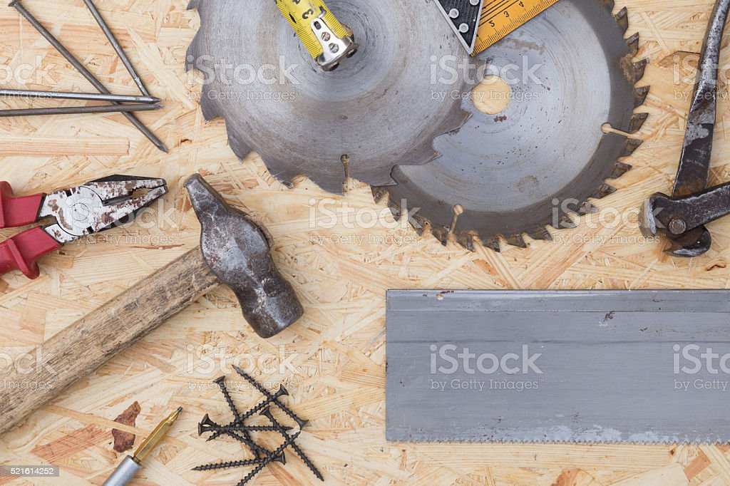 Tools on osb panel with copy space.  Carpenter workplace. stock photo