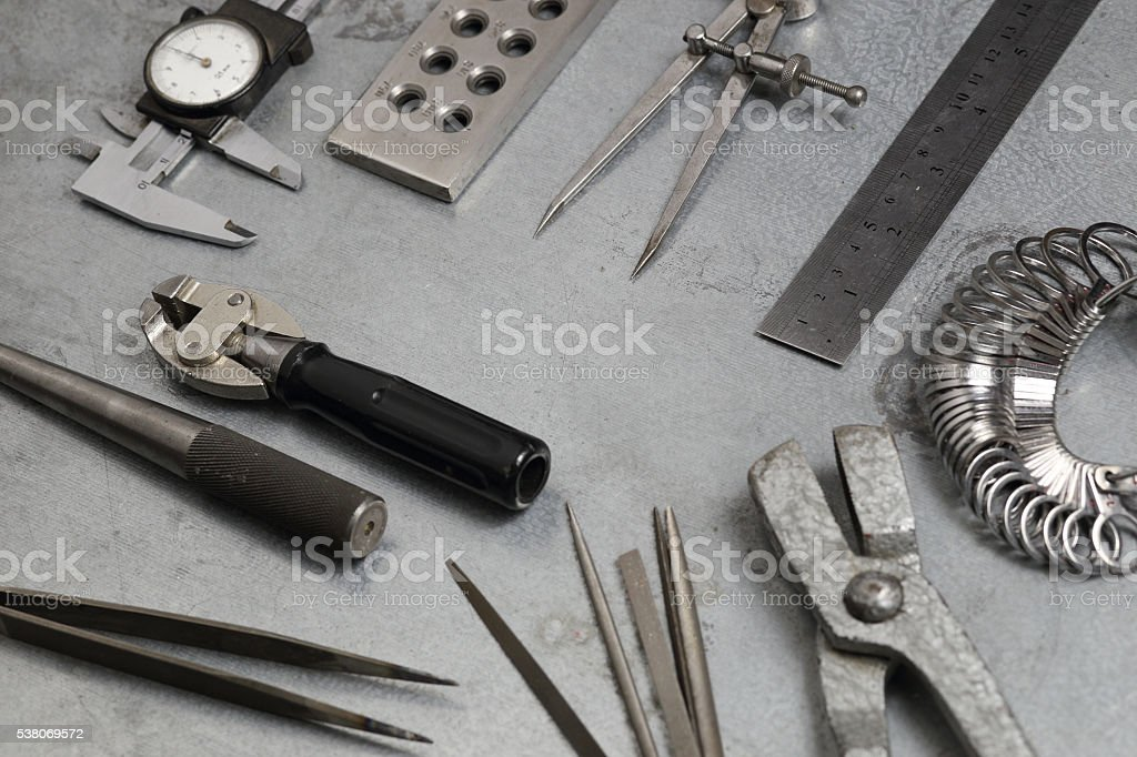 Tools set of jewellery. Jewelry workplace on metal background stock photo