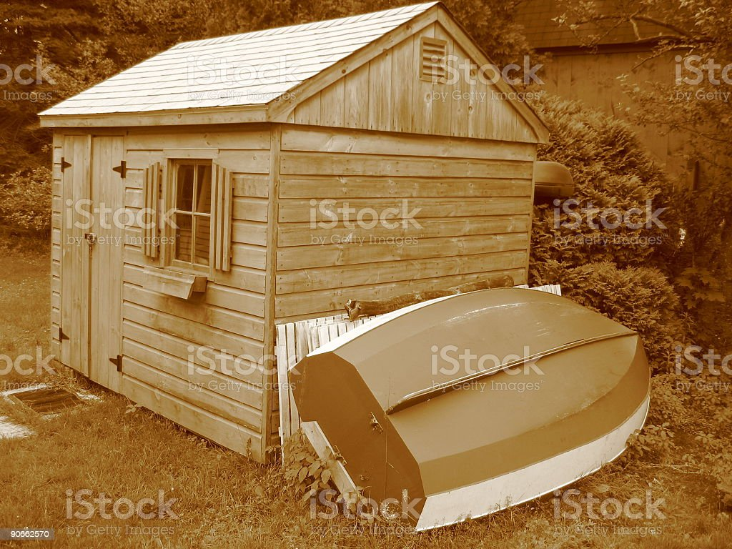 Toolshed with Rowboat royalty-free stock photo