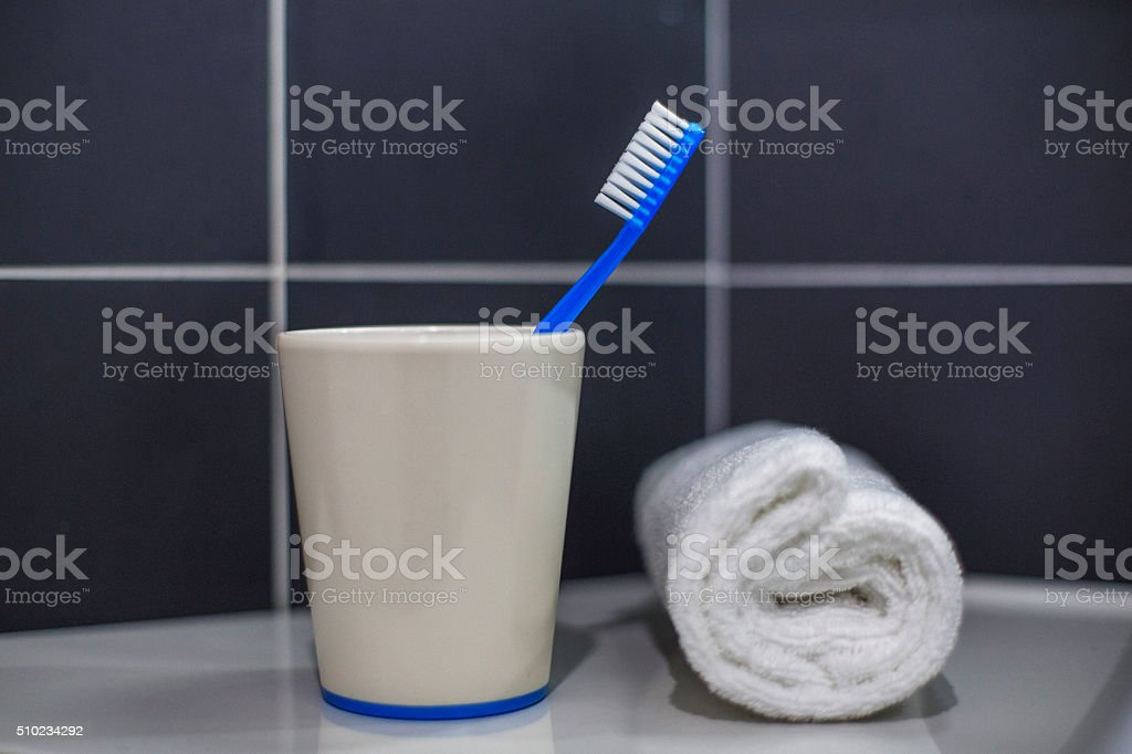 tooth brush and towel roll stock photo