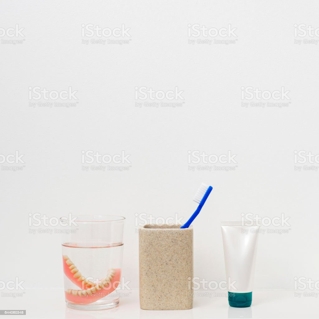 Tooth brushe, paste tube and dental plates stock photo