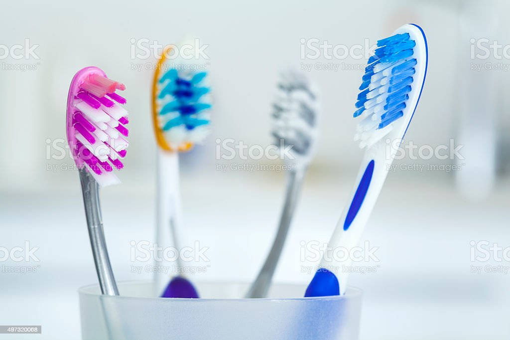 Tooth brushes in glass stock photo