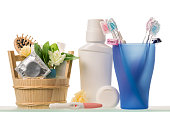 Tooth brushes, razors, lotion, toothpaste and deodorant isolated on white.
