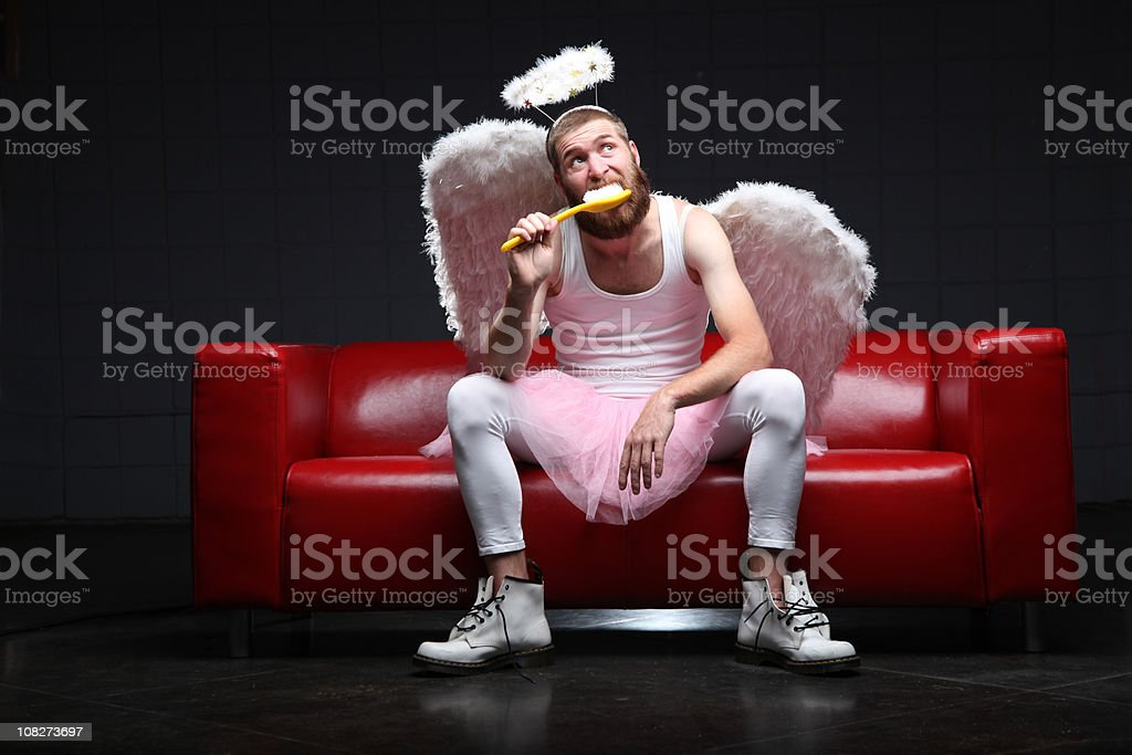 Tooth Fairy: brushing teeth with giant toothbrush stock photo