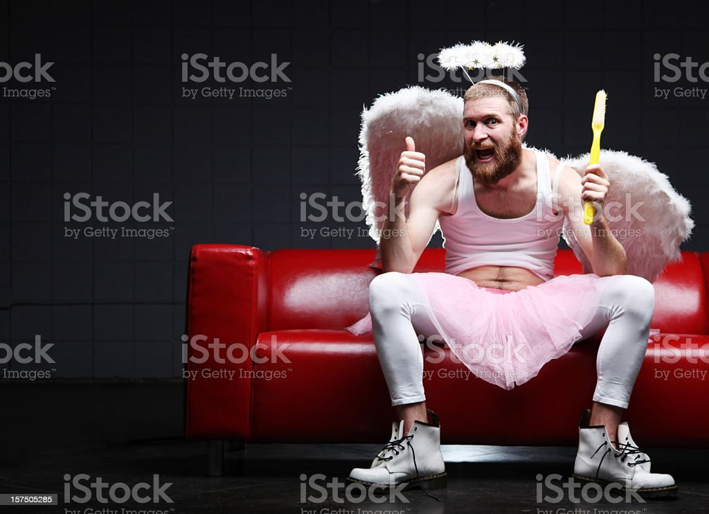 Tooth Fairy: thumbs up with giant toothbrush stock photo