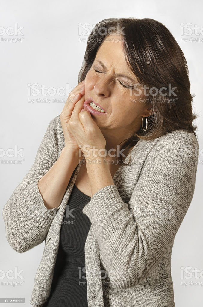 Toothache from a cavity stock photo