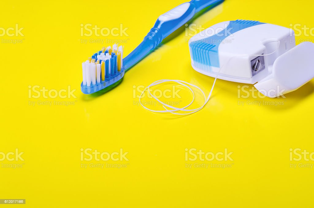 Toothbrush and dental floss stock photo