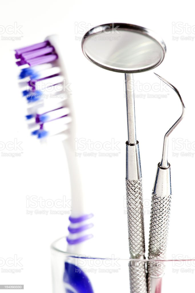 Toothbrush and Dental mirror - explorer in glass stock photo