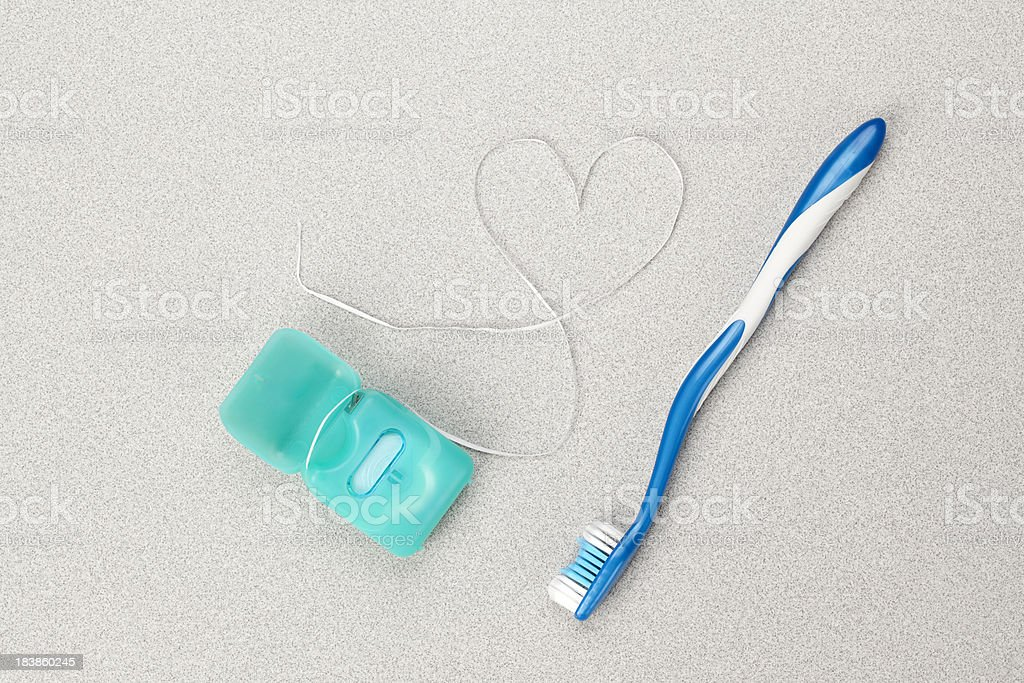 Toothbrush and Floss stock photo