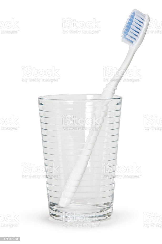 Toothbrush in a bathroom glass royalty-free stock photo