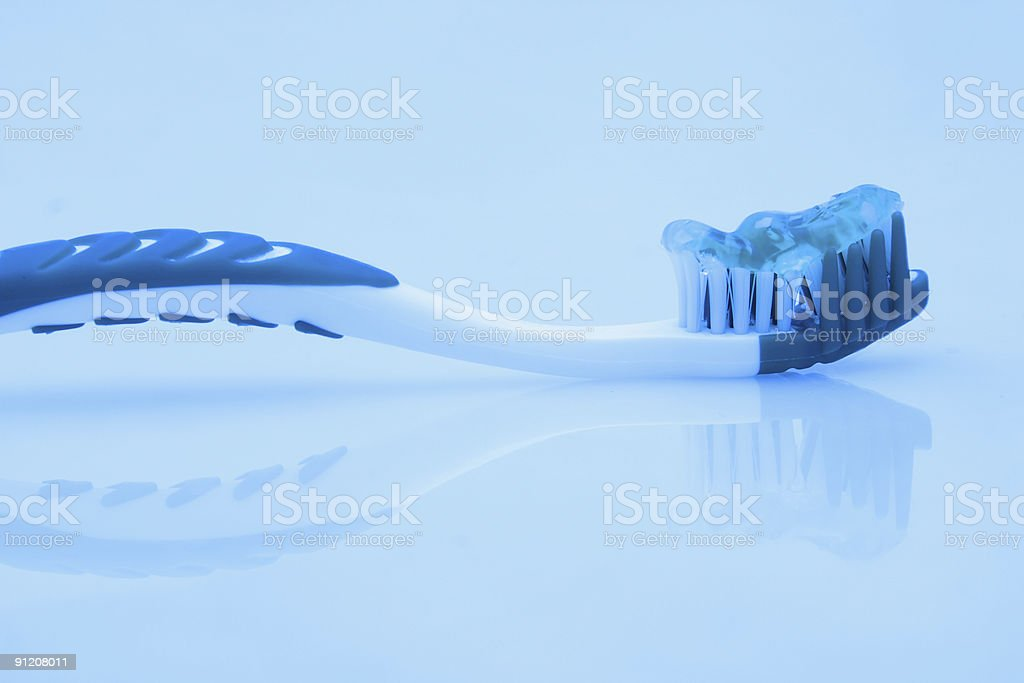 Toothbrush in blue royalty-free stock photo
