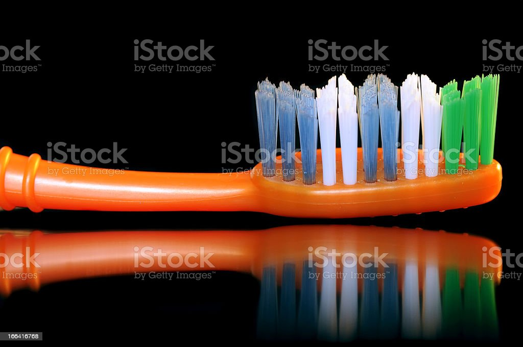 Toothbrush on Black Background royalty-free stock photo
